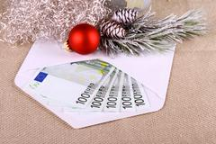 500 euro money in envelope with christmas deco - stock photo