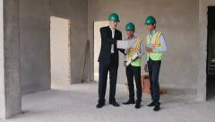 2of23 Manual worker, engineer and architect in construction site Stock Footage