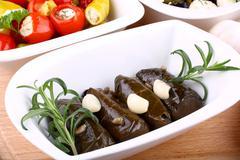 vine leaves stuffed and garlic with mediterranean antipasto - stock photo