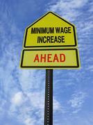 monimum wage increase ahead - stock photo