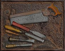 vintage woodworking tools over plate - stock photo