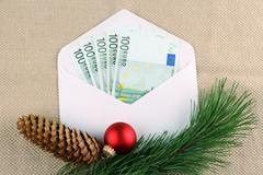 Stock Photo of five hundred euro money in envelope with christmas deco