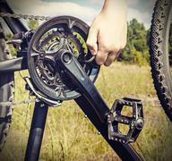 Hand with key repairs bike Stock Photos