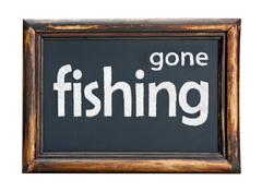 blackboard with the inscription gone fishing - stock photo