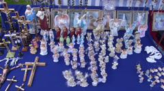Christianity objects and souvenirs in market - stock footage