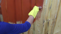 Painting wooden plank farm  house wall with paintbrush Stock Footage