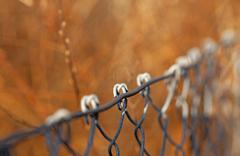 chain link fence on colorful backgroun - stock photo