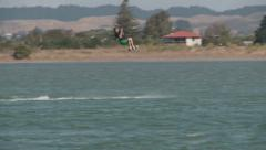 Kite surfer performs a jump Stock Footage