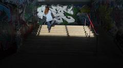 Girl walk upstairs from city underground dark passage subway Stock Footage
