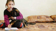 Girl doing lessons together with your puppy Stock Footage