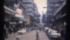 Old home movie Hong Kong street driving POV 1960s Stock Footage