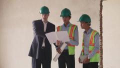 12of23 Workers, engineer and architect, new building - stock footage