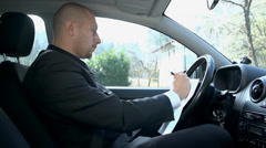 Young Businessman With Sad Expression Writing Letter in Car - stock footage