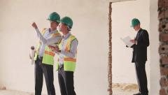 13of23 Manual workers, engineer and architect in construction site, teamwork - stock footage