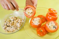 Closeup of cook stuffing tomato salad Stock Photos