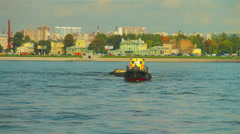 Small load ship with boat on hook passing through Neva river Stock Footage