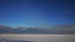 Frozen Onega lake under blue sky Stock Footage