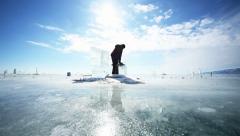 Man cuts ice Stock Footage