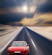 Red car on desert road Stock Photos
