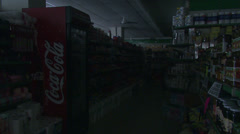 Small independent grocery store with lights being turned on at beginning of day - stock footage