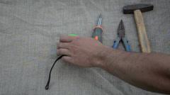 Man hand put hammer pliers screwdriver measure knife tools Stock Footage