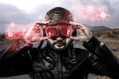 Speed red  light effects in googles biker with black leather jacket and old g Stock Illustration