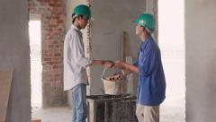 21of23 Manual workers, masons in construction site, building house - stock footage
