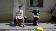 Young kids teenagers play drum rhythm outdoor. street music day Stock Footage