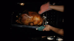 Old home movie film Thanksgiving turkey out of oven Stock Footage