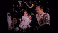 Old home movie film baby and Christmas tree 1960s Stock Footage