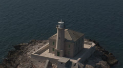 Aerial view of a small island with a lighthouse Stock Footage