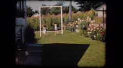 Old film home movie two girls children playing on swing - stock footage