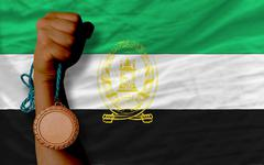Bronze medal for sport and  national flag of afghanistan Stock Photos