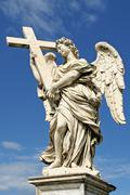 sculpture of angel with cross. rome, italy. - stock photo