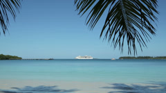 Cruise ship in bay, palm trees, tropical island, isle of pines, new caledonia Stock Footage