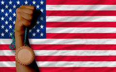 bronze medal for sport and  national flag of america - stock photo