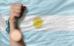 Stock Photo of bronze medal for sport and  national flag of argentina