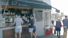 People at bondi beach ordering coffee Stock Footage