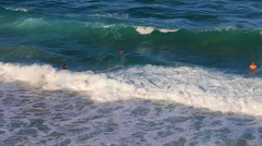 Close overhead view of people swimming in the tamarama beach waves Stock Footage
