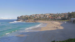 Wide and medium shot of people at bronte beach Stock Footage