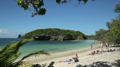 Tourists sunbathing at beach, isle of pines, new caledonia Stock Footage