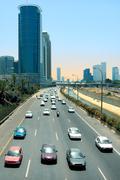 cars passing on ayalon freeway in tel aviv, israel. - stock photo