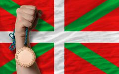 Stock Photo of bronze medal for sport and  national flag of  of basque