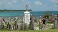 Tourists visit st maurice bay wood carving, isle of pines, new caledonia Stock Footage