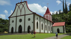 Tourists visit lady of the assumption church, isle of pines, new caledonia Stock Footage