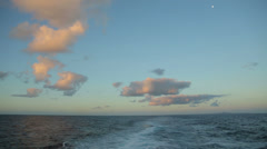 Sunset clouds, sky and wake from ship at sea Stock Footage