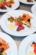 Buffet style food on plates - stock photo