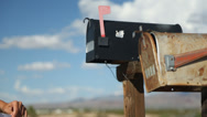 Stock Video Footage of Girl putting letter in mailbox
