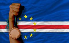 bronze medal for sport and  national flag of  of capeverde - stock photo