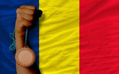 Stock Photo of bronze medal for sport and  national flag of  of chad